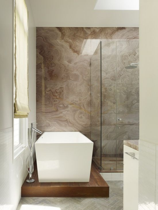Modern bathroom with what looks like an Onyx Stone Slab on the shower wall!