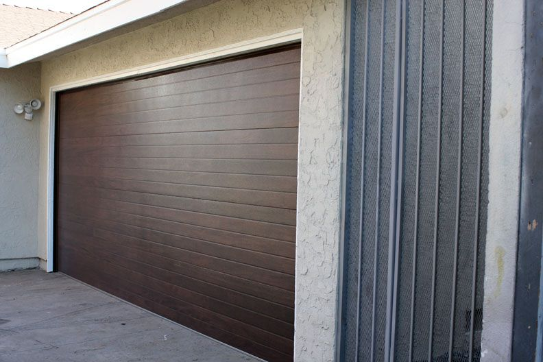 New Horizontal Wood Slat Garage Door On Remodeled Long Beach Home
