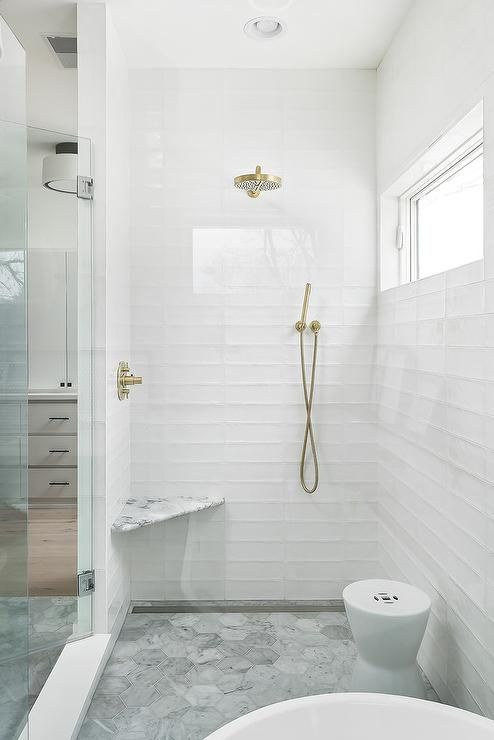 Stunning Seamless Glass Shower Boasts White Glass Stacked Tiles Fitted With A Bras Shower Kit Located O White Bathroom Tiles Farmhouse Shower Shower Renovation