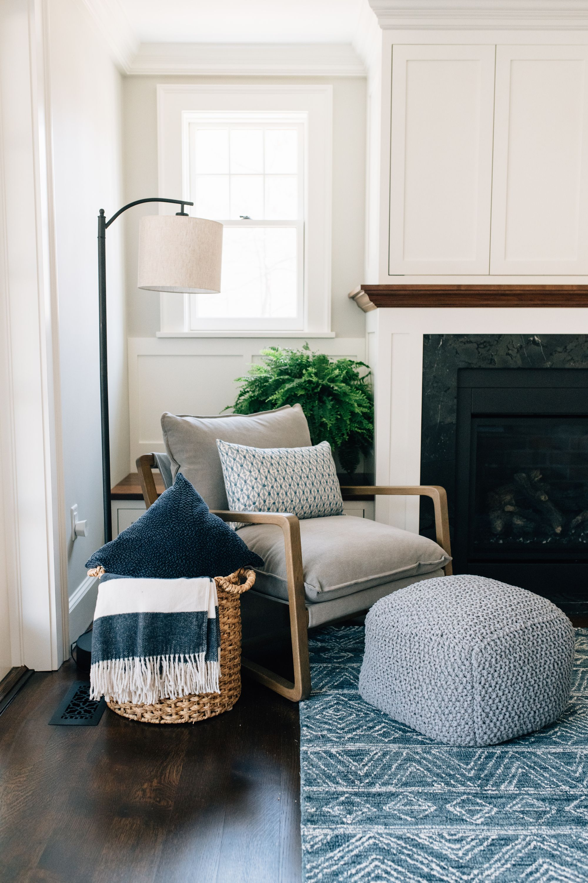Modern Reading Nook Open Arm Chair Pouf Floor Lamp Blue And Gray Palette Fireplace Built In In 2020 Living Room Nook Bedroom Seating Area Bedroom Seating