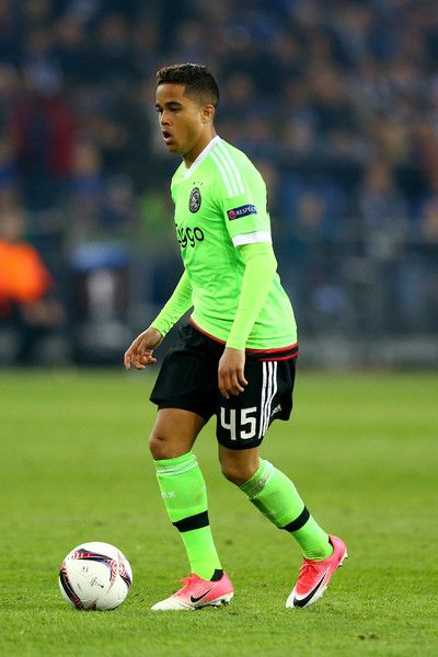 Justin Kluivert of Amsterdam runs with the ball during the UEFA Europa  League quarter final second leg match between FC Schalke 04 and Ajax  Amsterdam at ... d9fef3993fda3