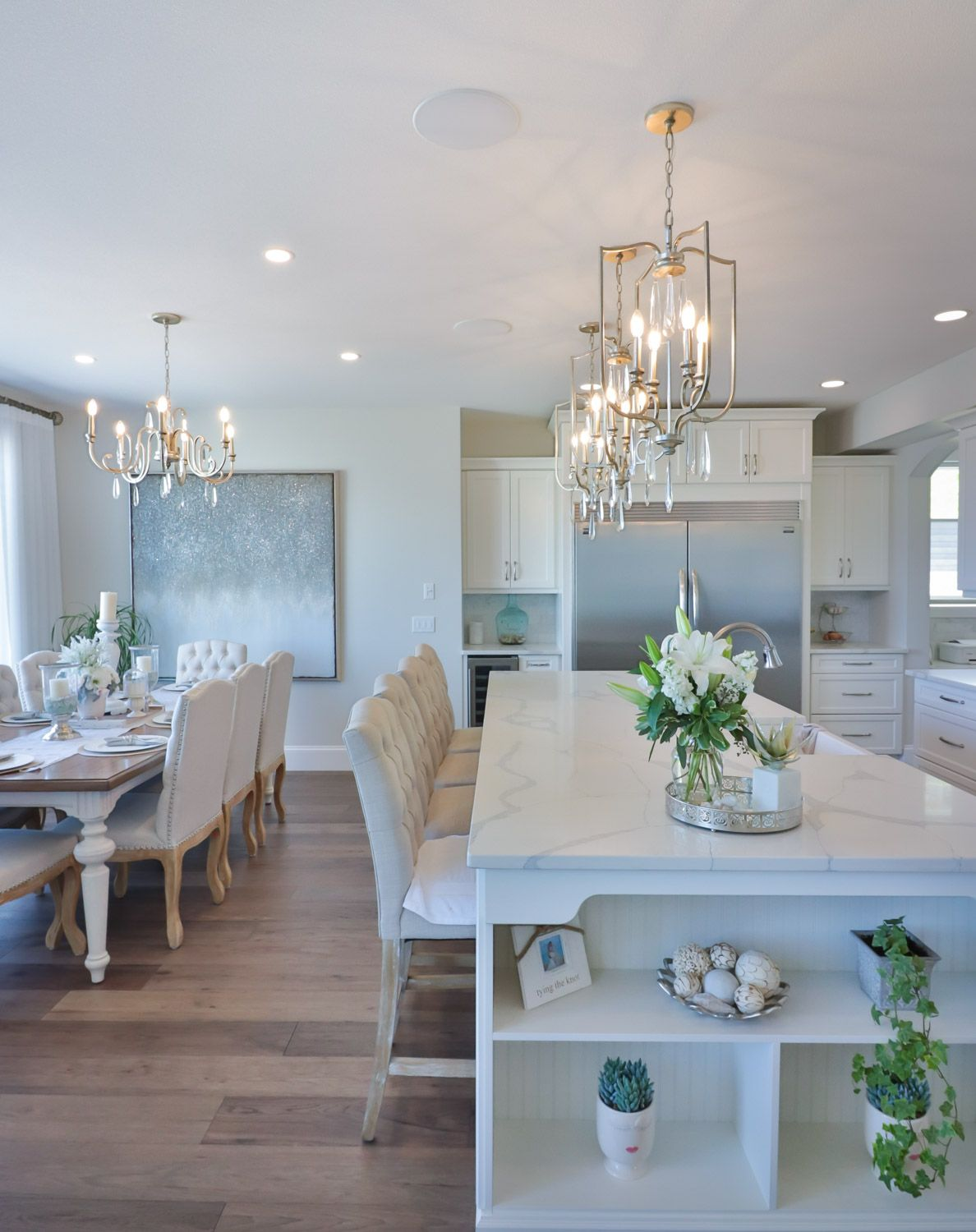 Three pendants over kitchen island and complimentary chandelier ...