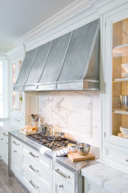 The marble works for kitchen  bath bk wood not stainless hood glass cabinet to counter waterfall also cool vent hoods accentuate your design kitchens