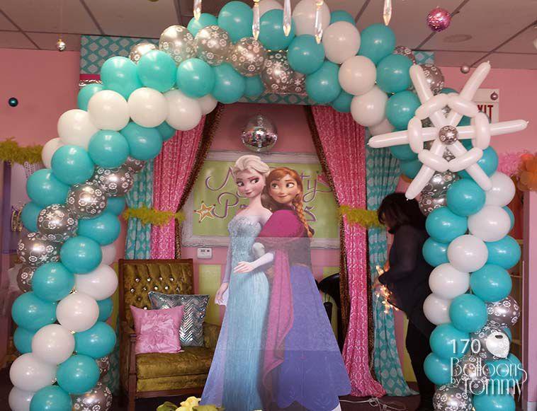A Frozen inspired balloon arch for a pretty princess birthday