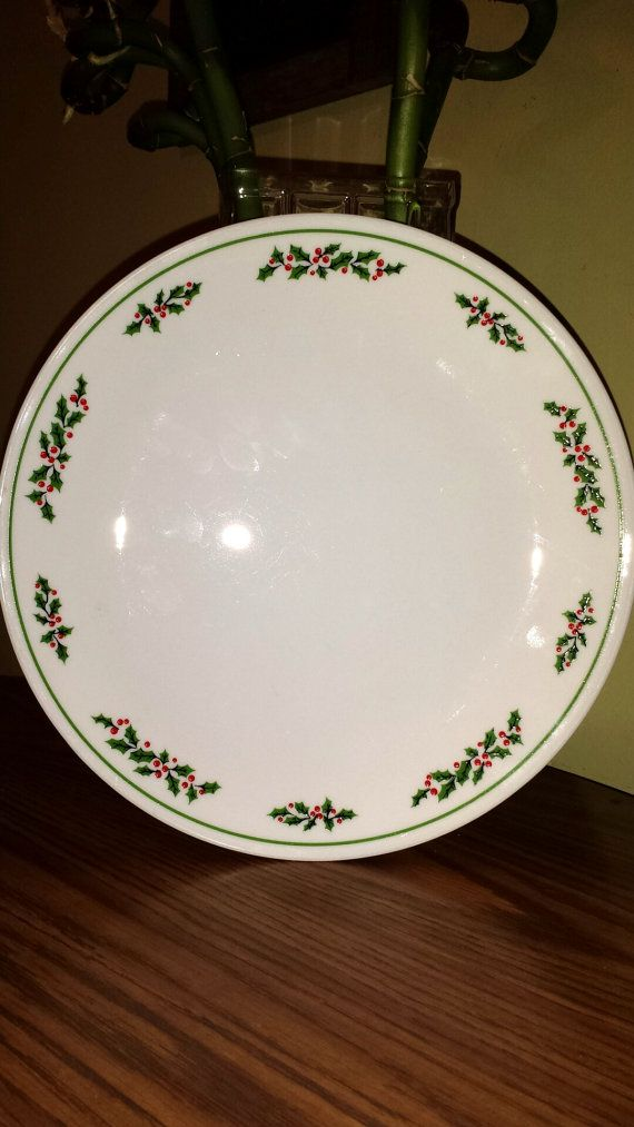 Vintage: Corning/Pyrex Christmas Holly Days Plates 1980s. 9 total. They are decorated with the Holly Days pattern, which dates back to 1985. I want vintage Christmas pyrex!!
