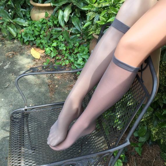 Nude women with knee high socks