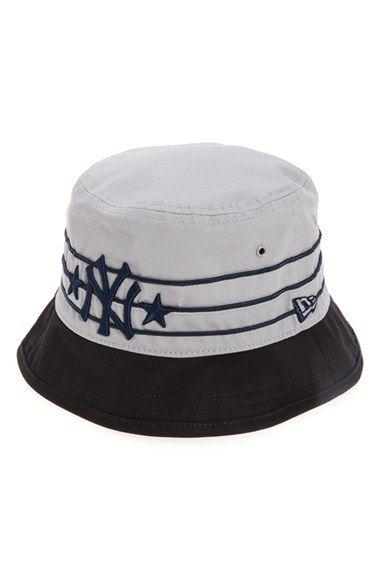 66898691ac3 New Era Cap  Wraparound - New York Yankees  Cotton Bucket Hat. Find this  Pin and ...