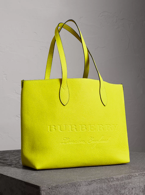 45ffdd963db A versatile tote bag by Burberry in a vibrant neon tone, with an interior  zip pocket for small essentials. The minimalist design is finished with  embossed ...