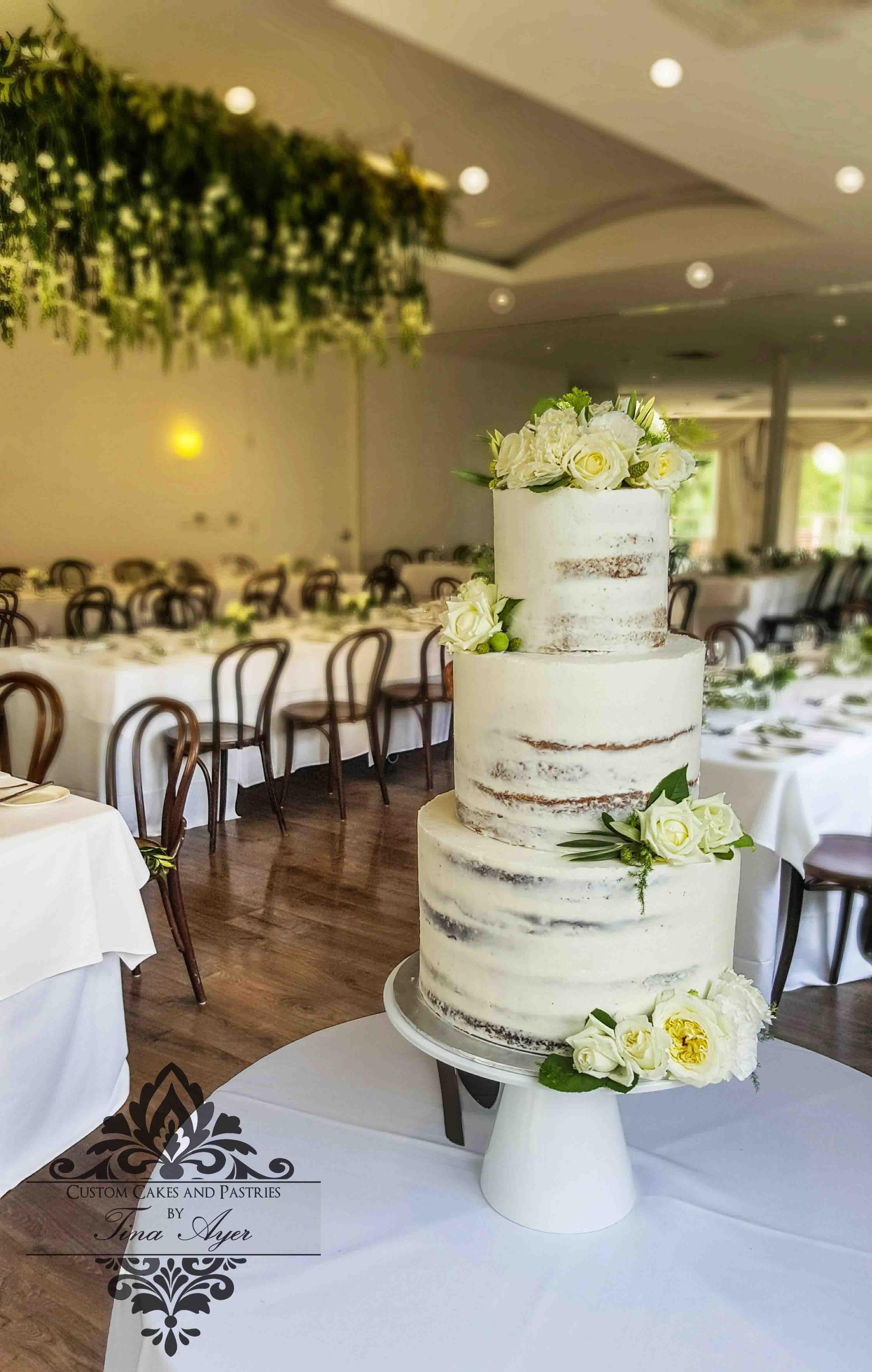 Semi naked wedding cake with white flowers and greenery custom semi naked wedding cake with white flowers and greenery custom cakes by tina ayer mount junglespirit Choice Image