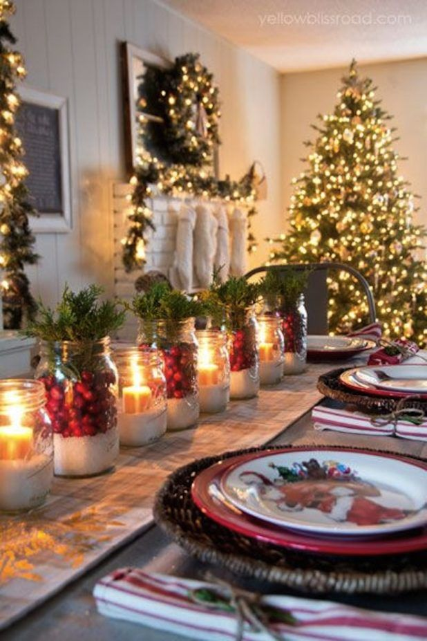 Decorating. Creating Your Prettiest Christmas Table Centerpiece. Special Dinner In Christmas Night Design Featuring Wonderful Christmas Candle Glass Lanterns And Red Fruit Christmas Centerpiece Ideas And Big Green Christmas Tree With Lamps Together With White Tone Tablecloth For Dining Table
