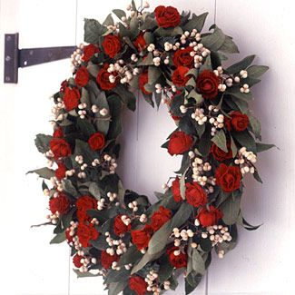 dried red roses, white berries, and bay leaves onto a straw wreath form -- making it as lush and full as possible.