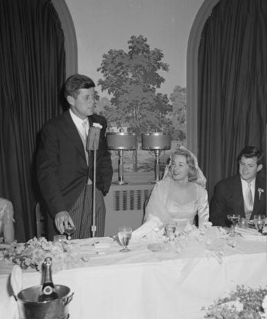 The new Mr. & Mrs. Ted Kennedy host their reception at the Bronxville Country Club. Society columnists called this one of the most important and beautiful weddings in years, and described the bridal couple as dazzling.