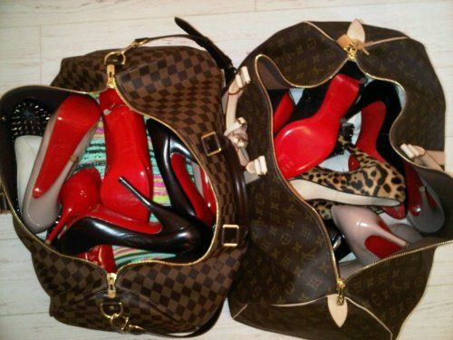 Louboutin heels in LV luggages