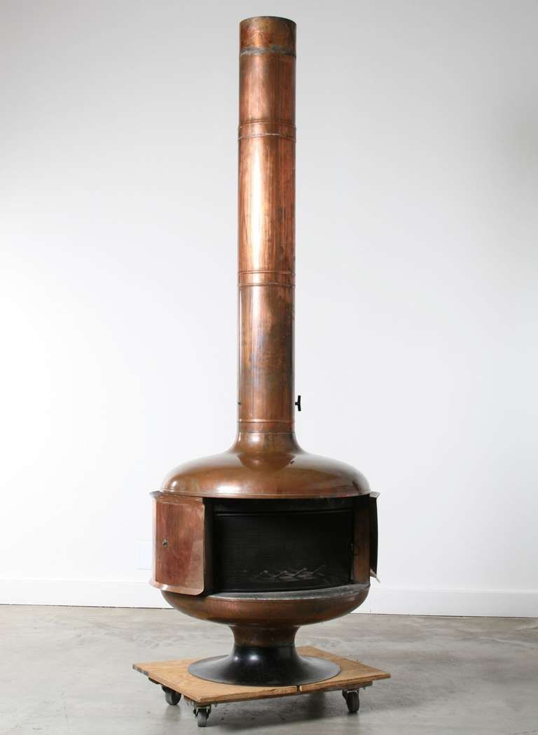 1970s copper fire drum 2 fireplace featured in pasadena design