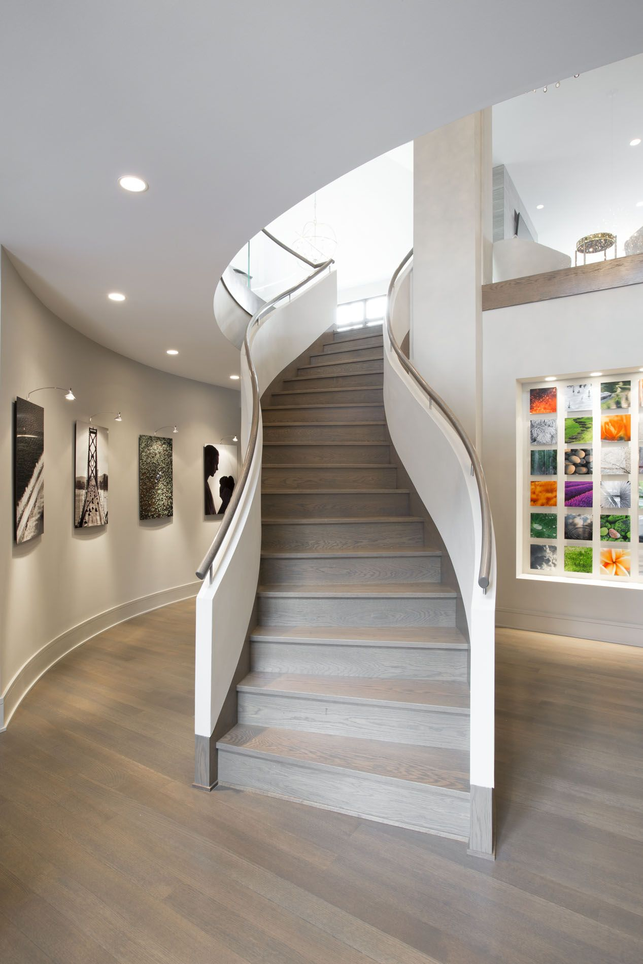 Curved staircase curved glass gallery wall gray stained for Catwalk flooring