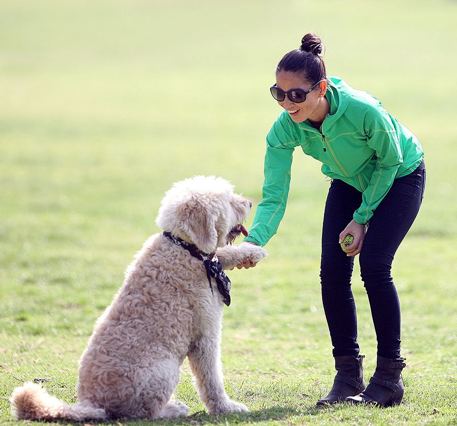 IOlivia Munn playing with her dog in Los Angeles. The
