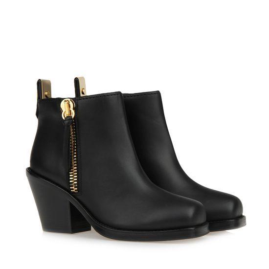 Black calfhide half boot with gold zip.