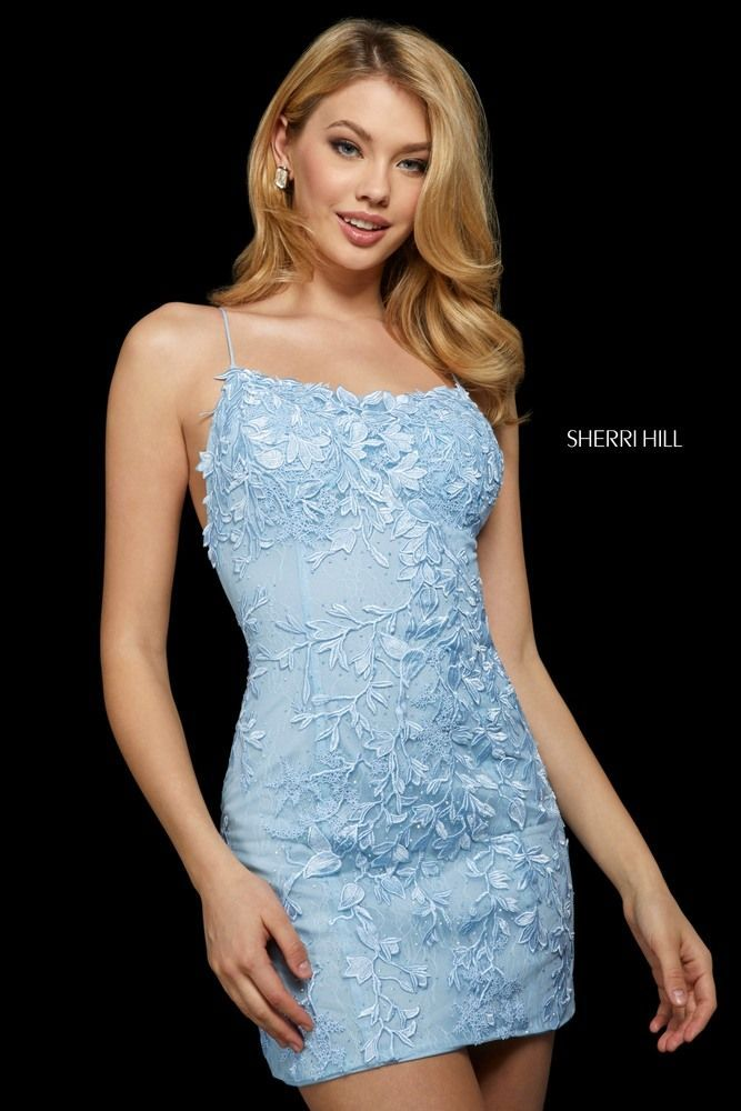 This Sherri Hill 53151 light blue short party dress features a fitted silhouette with a curved neckline and spaghetti straps that define the lace-up open back. Floral embroidery coats this slim cocktail dress.