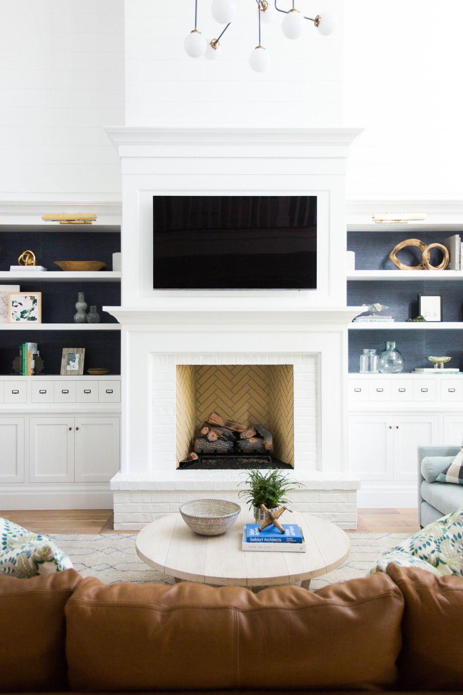 Herringbone tile firebox and wood surround