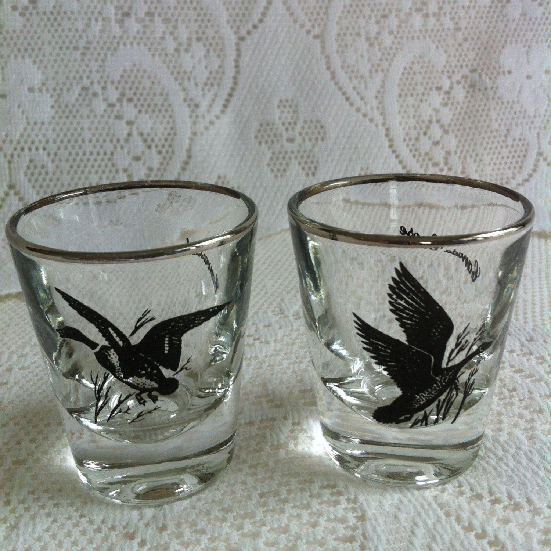 Vintage silver rimmed pair of shot glasses handpainted