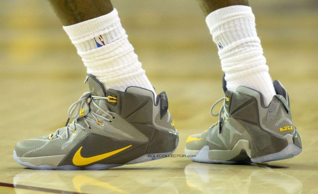 buy online 66939 9b3e4 LeBron James wearing Nike LeBron XII 12 Grey Yellow PE on December 2, 2014