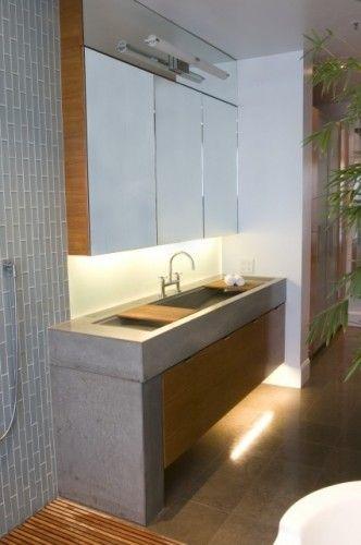 Un grand lavabo de béton Ju0027aime les plaques de bois quu0027on peut