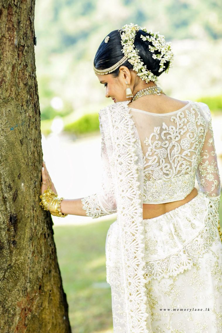 What a beautiful large low bun with gajra & flowers! Care however ...