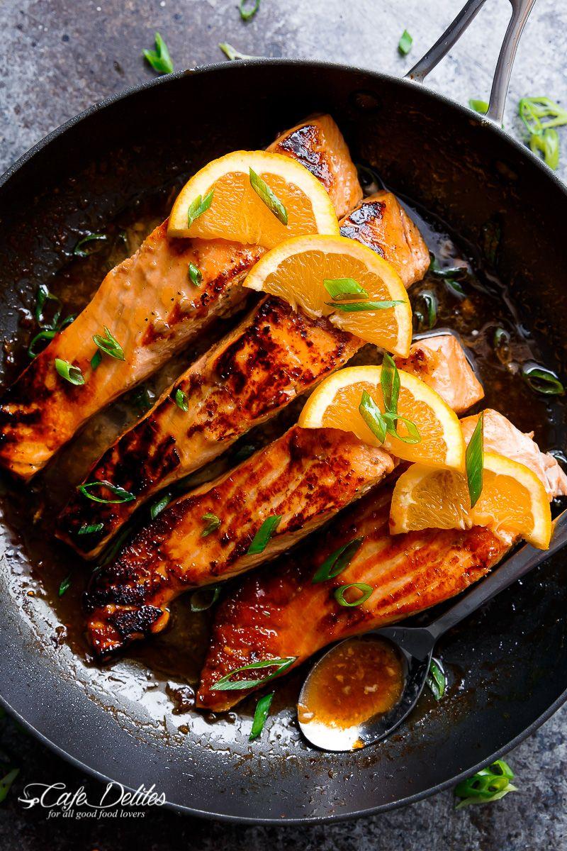 Crispy Honey Orange Glazed Salmon Fillets Are Pan Fried In