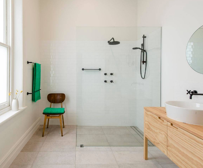 The less grout lines in a room, the better. The room looks larger and there is less grout to clean. Because we all know that this means that big tiles are the go, but how do you use a big tile in a bathroom that is on the smaller side? Strip Drains! By using a …