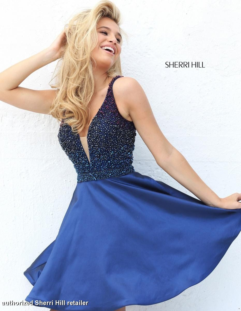 This sleeveless Sherri Hill 50749 dress features a plunging V neckline,  jeweled top, and