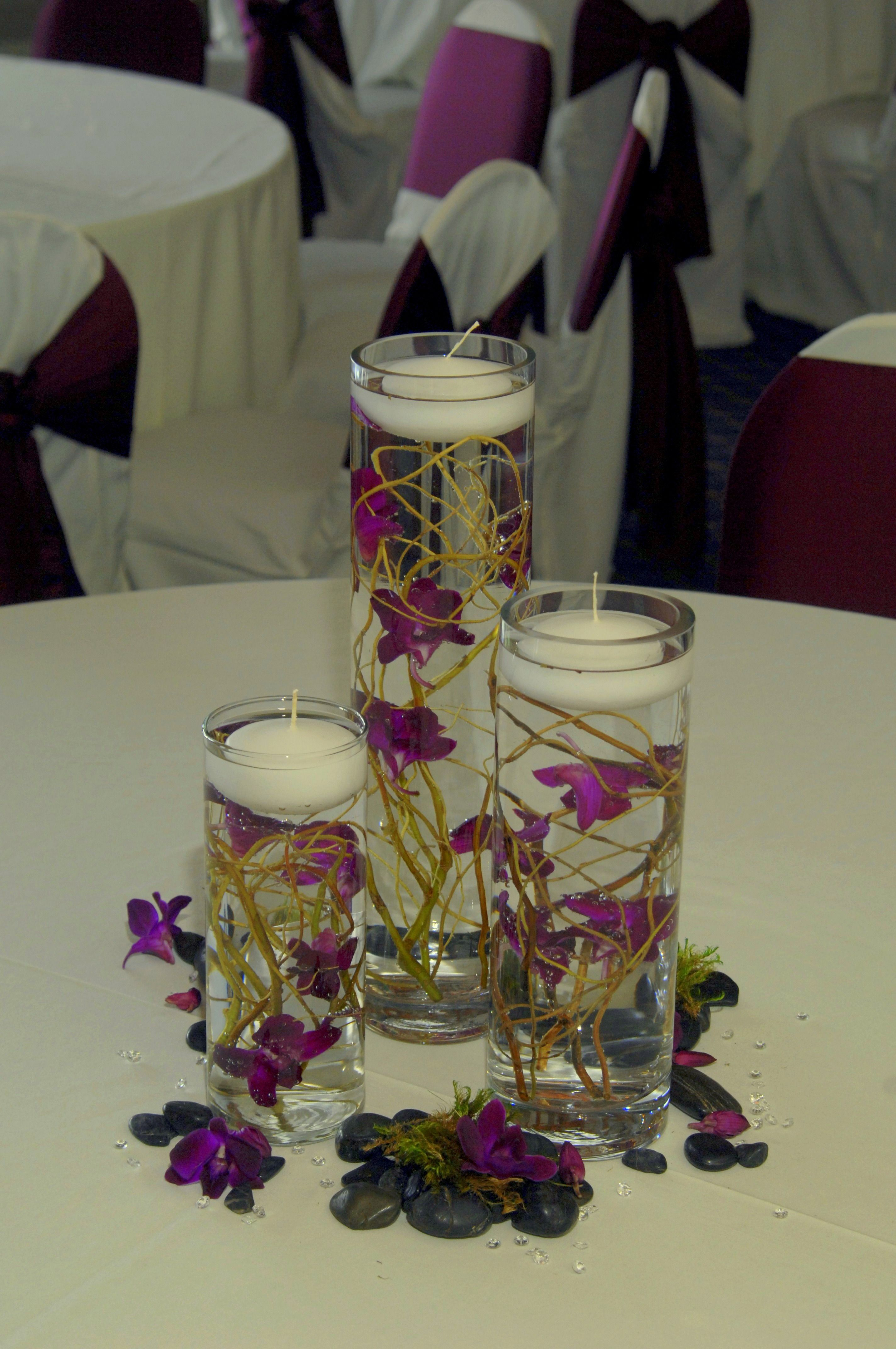 Forget me not floral design submerged orchid centerpiece