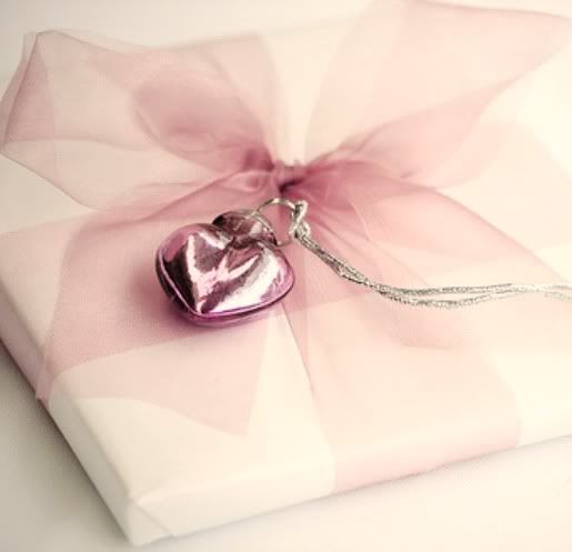 pale pink tulle or organza bow ...tie a sweet charm on to ...