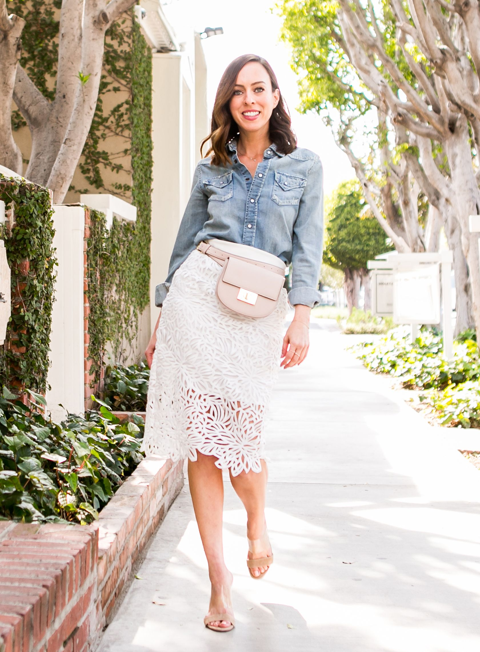 8df99a7ff73b Sydne Style shows classic outfit ideas in milly white lace pencil skirt   lace  springoutfits  white  chambray  beltbag