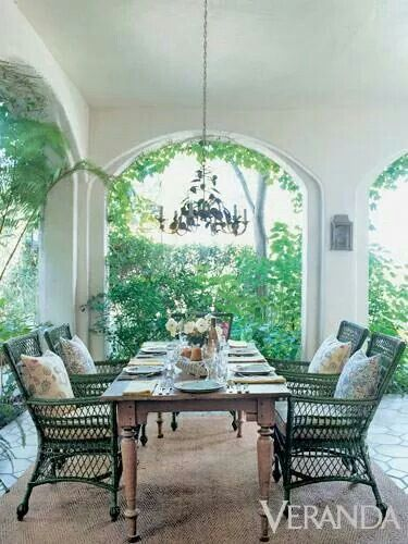 ♥ A rustic table is used as an unconventional anchor for an outdoor dining area
