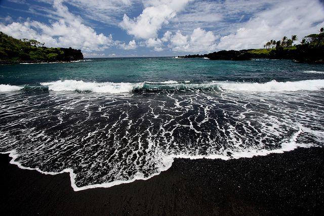 Black sand beach at Waianapanapa State Park, in Maui, Hawaii