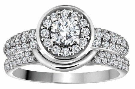 1.10 CARAT TOTAL WEIGHT DIAMOND ENGAGEMENT RING.