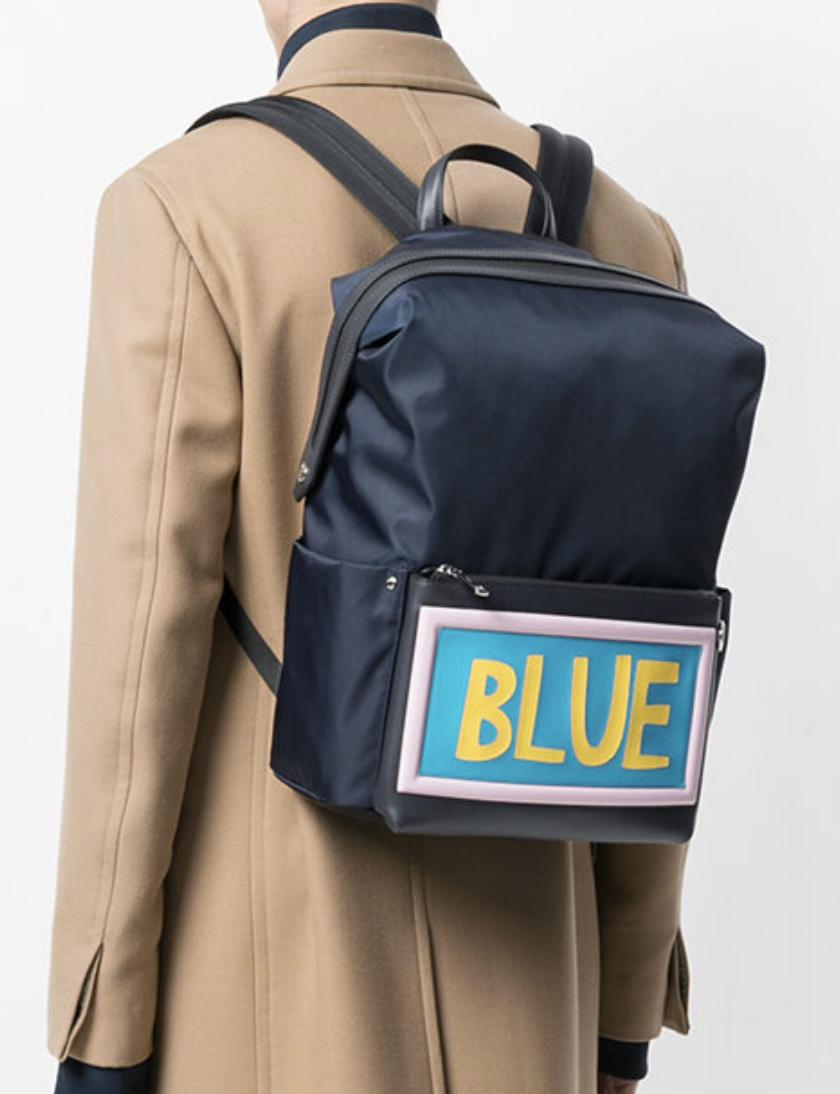 89e3ff51ac FENDI Blue slogan patch backpack from Farfetch (men