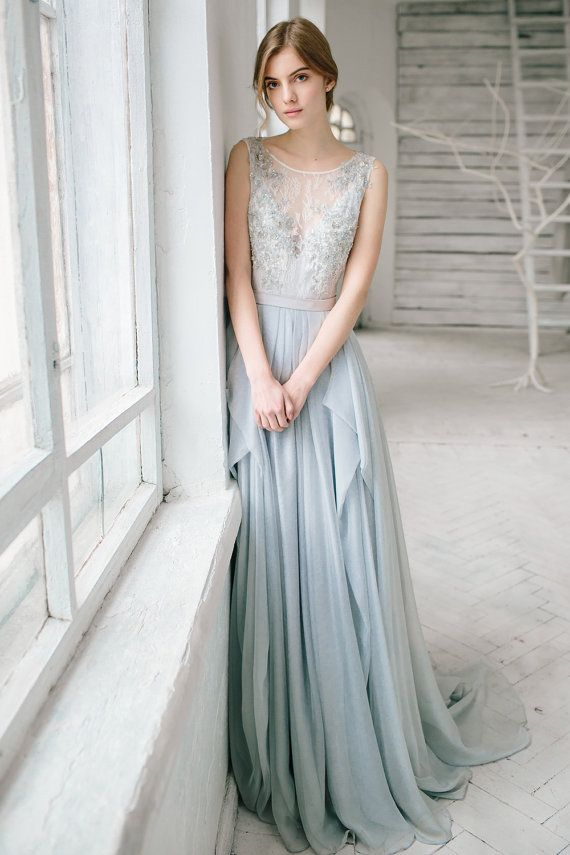 0697926b73ed This is beautiful gray wedding dress. The top tart is made in off-white  lace and has silver hand beading. The dress is lined in front with gray