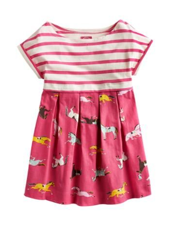 Joules Girls Jersey Dress, Candy Pink Pony Print.                     With a smattering of stripes sat cheerfully on top of a floaty and frilly skirt, this dress will be a great choice for any girl throughout the warmer months of the year. Crafted from soft cotton jersey that looks as good as it feels.