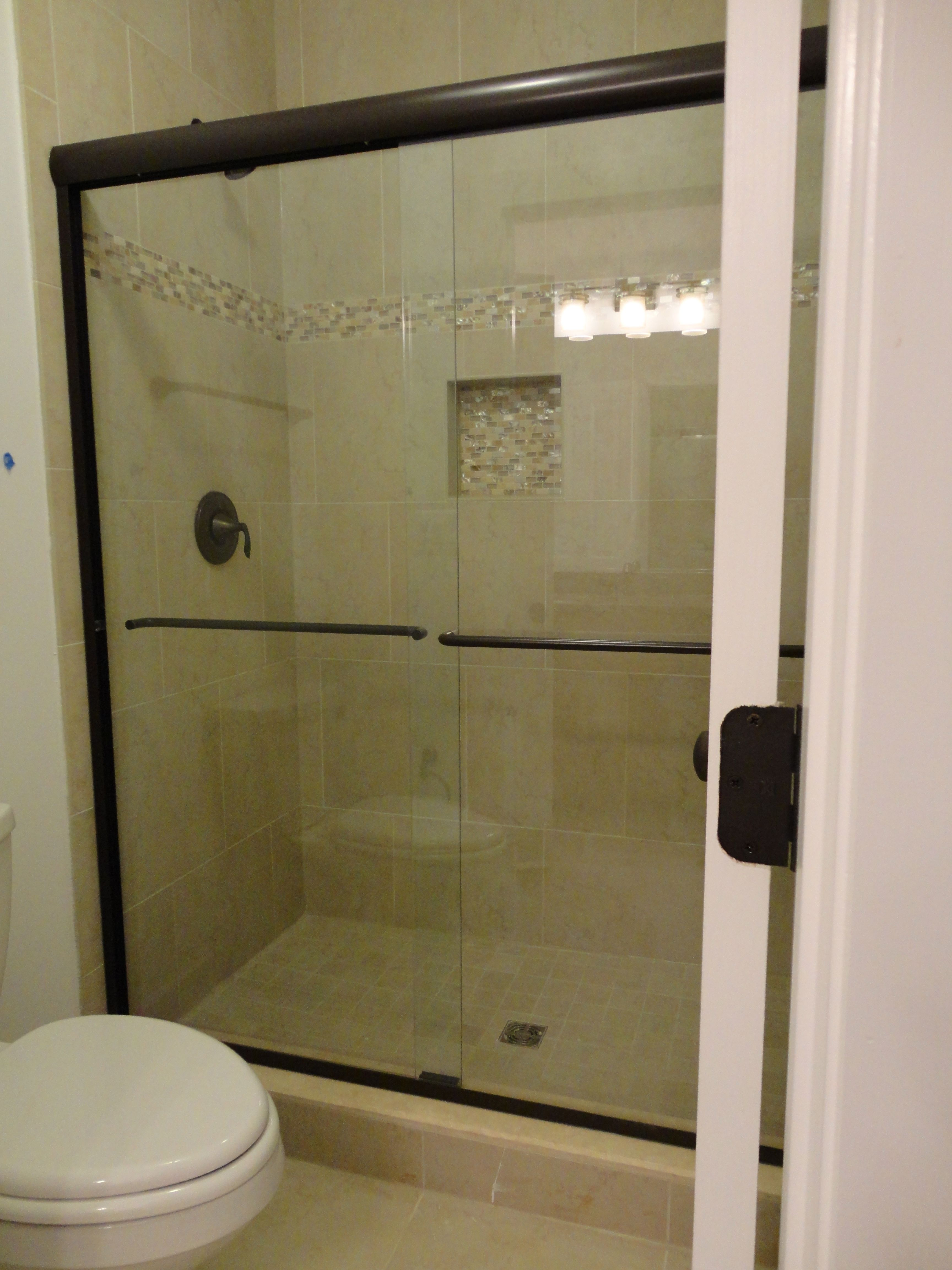 Shower Bypass In Oil Rubbed Bronze And 1 4 Clear Glass Glass Shower Shower Doors Shower Design