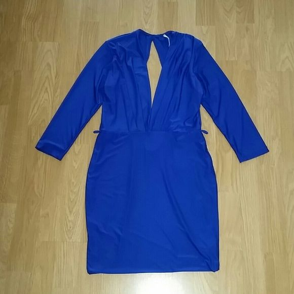 Royal blue dress Royal blue dress with plunging neckline and cut out back.  Very sexy!  It has belt loops, but belt not included.  Only worn once,  in perfect condition. Dresses Long Sleeve