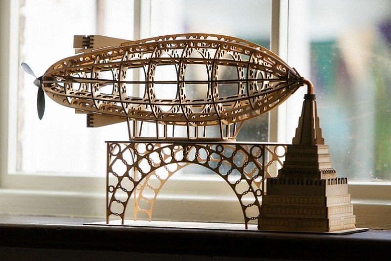 really nice steampunk centerpiece! too bad it's so expensive. wooden model kits by Cog o Two