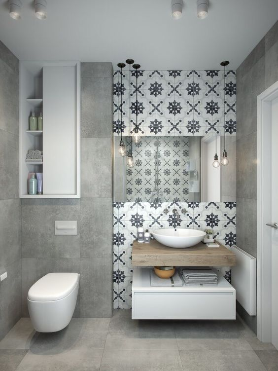 This Light Grey Bathroom Design Is Complemented Beautifully By A Patterned Tile Feature Small Apartment Bathroom Bathroom Decor Apartment Bathroom Design Small