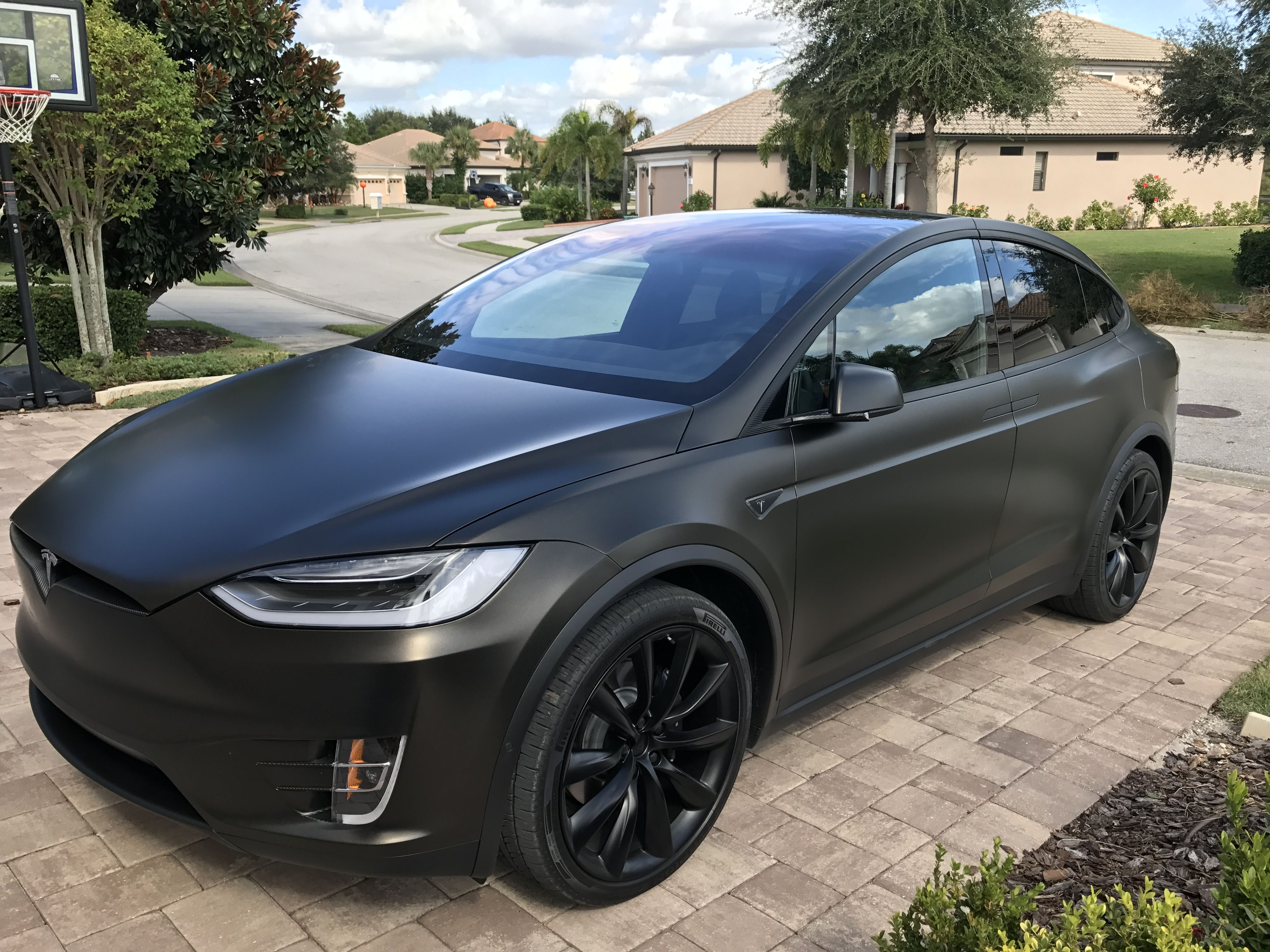 medium resolution of tesla model x black satin gold dust vinyl wrap with carbon fiber accents on chrome and all 6 seat backs imgur