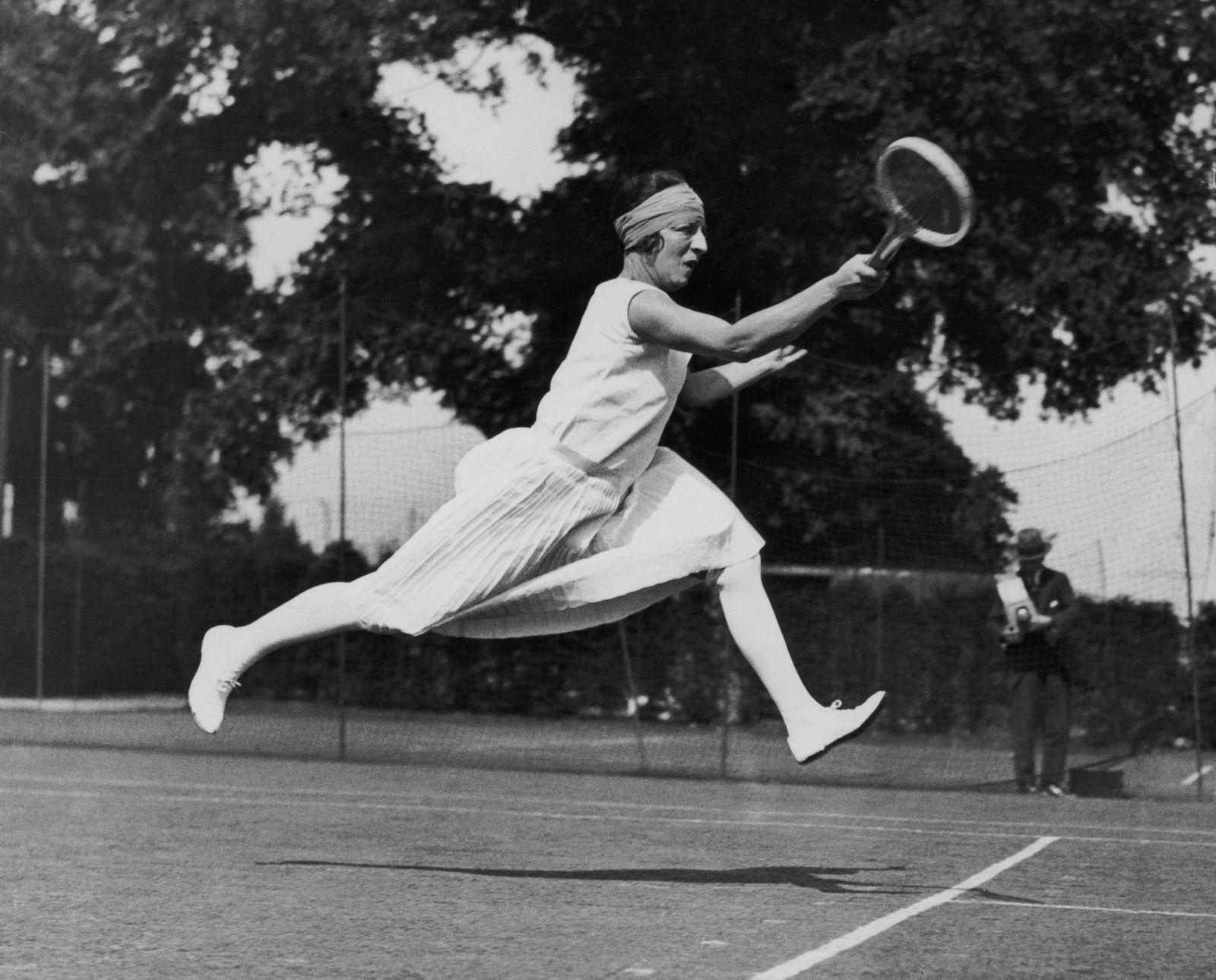 French tennis player Suzanne Lenglen petes at Wimbledon in 1926