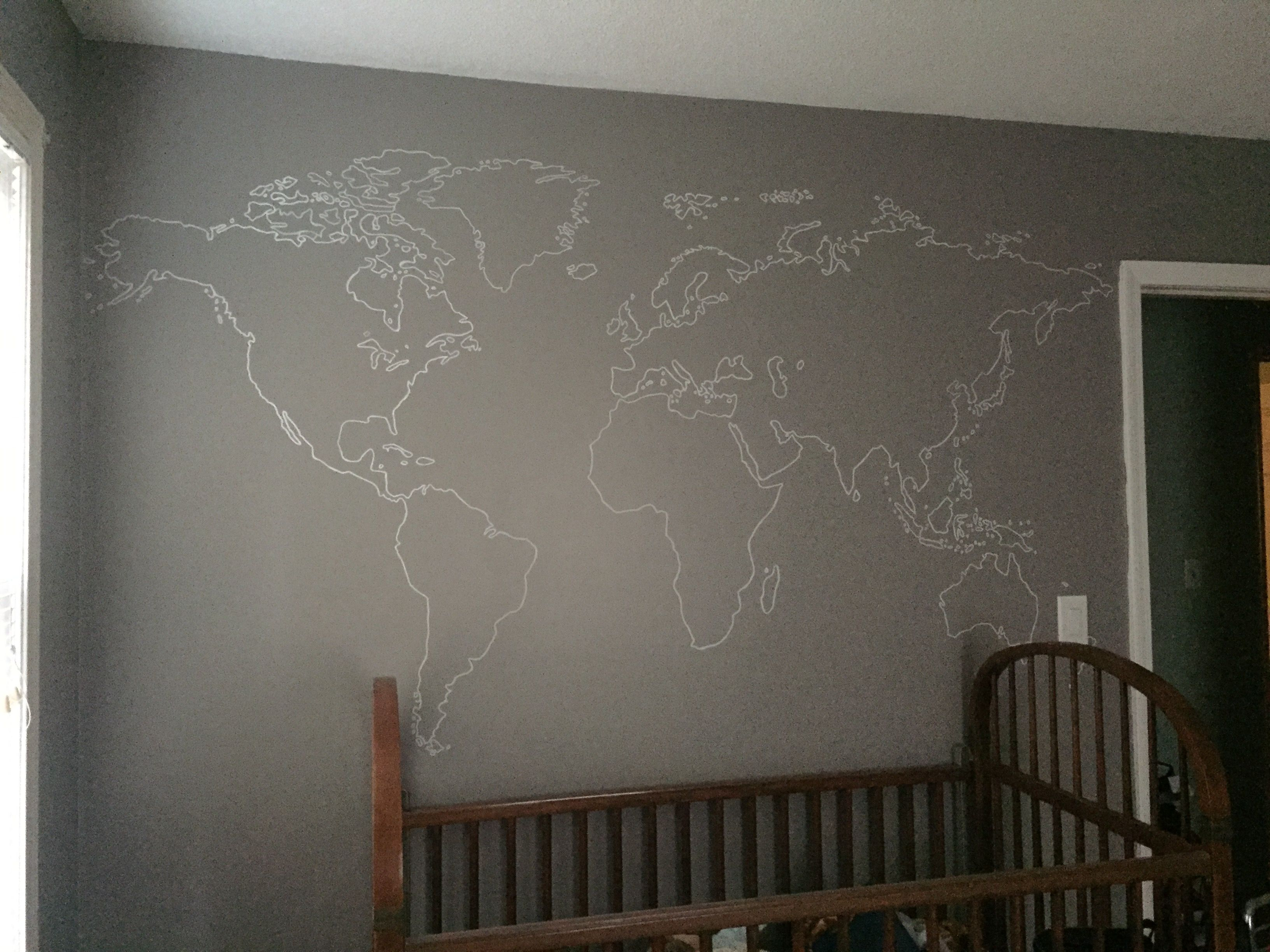 This is the world map that we traced using a projected image from a projector. We made it the size we wanted, went over the lines with a light pencil, then used a paint pen to trace over the pencil. It only took about 2 hours to complete and I am so happy with how it turned out! (this is for our son's aviator/airplane themed nursery)