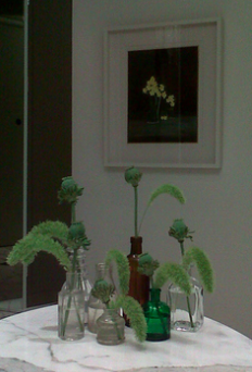 A few stems in separate vases can often be more effective than a huge bouquet of flowers