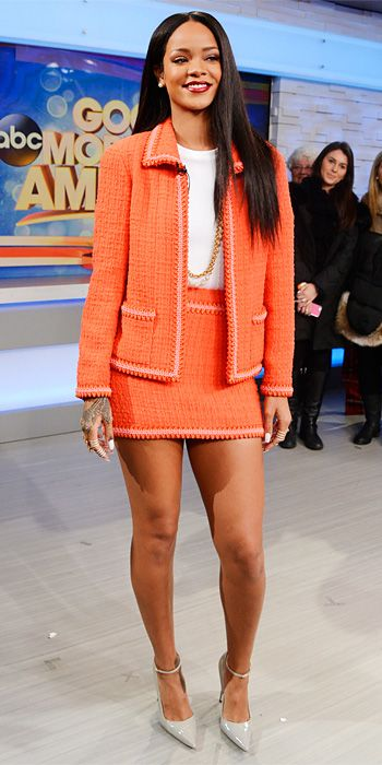 After an ultra-glam pre-Grammy look, Rihanna went in a decidedly more conservative direction with an orange tweed Chanel skirt set, styling it witha ribbed white Adam Selman bodysuit, a gold chain necklaces, a selection of armor rings and gray ankle-strap Manolo Blahniks.