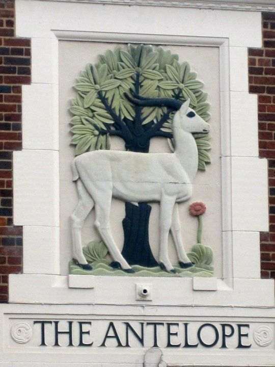 A carving done by my great grandpa Wright in Birmingham, England over The Antelope Pub. LMH