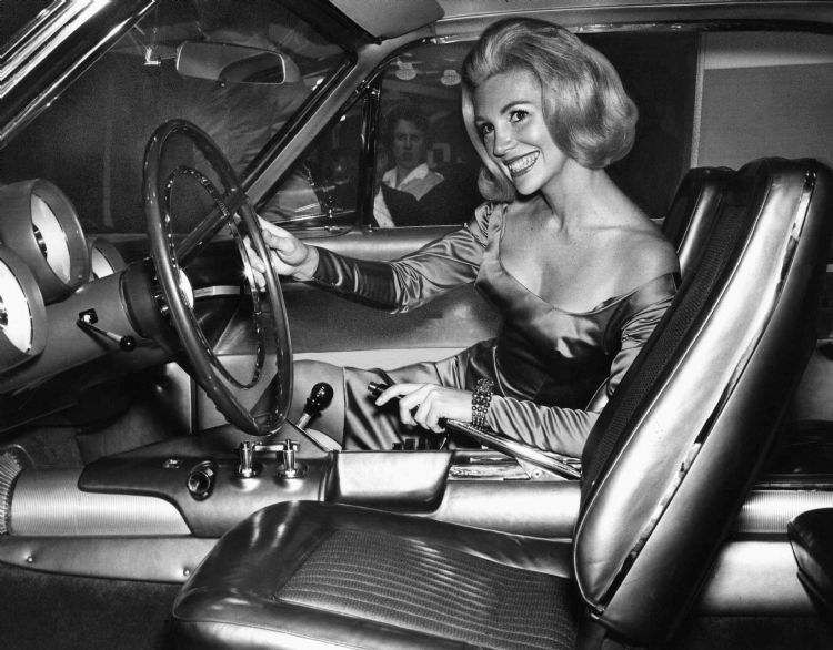 A Promotional Model For Chrysler Shows Off The Controls On -2477